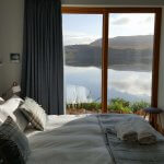 Bedroom with sea and hill view